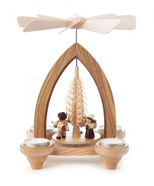 Weihnachtspyramide mit Handelsleuten für Teelichte